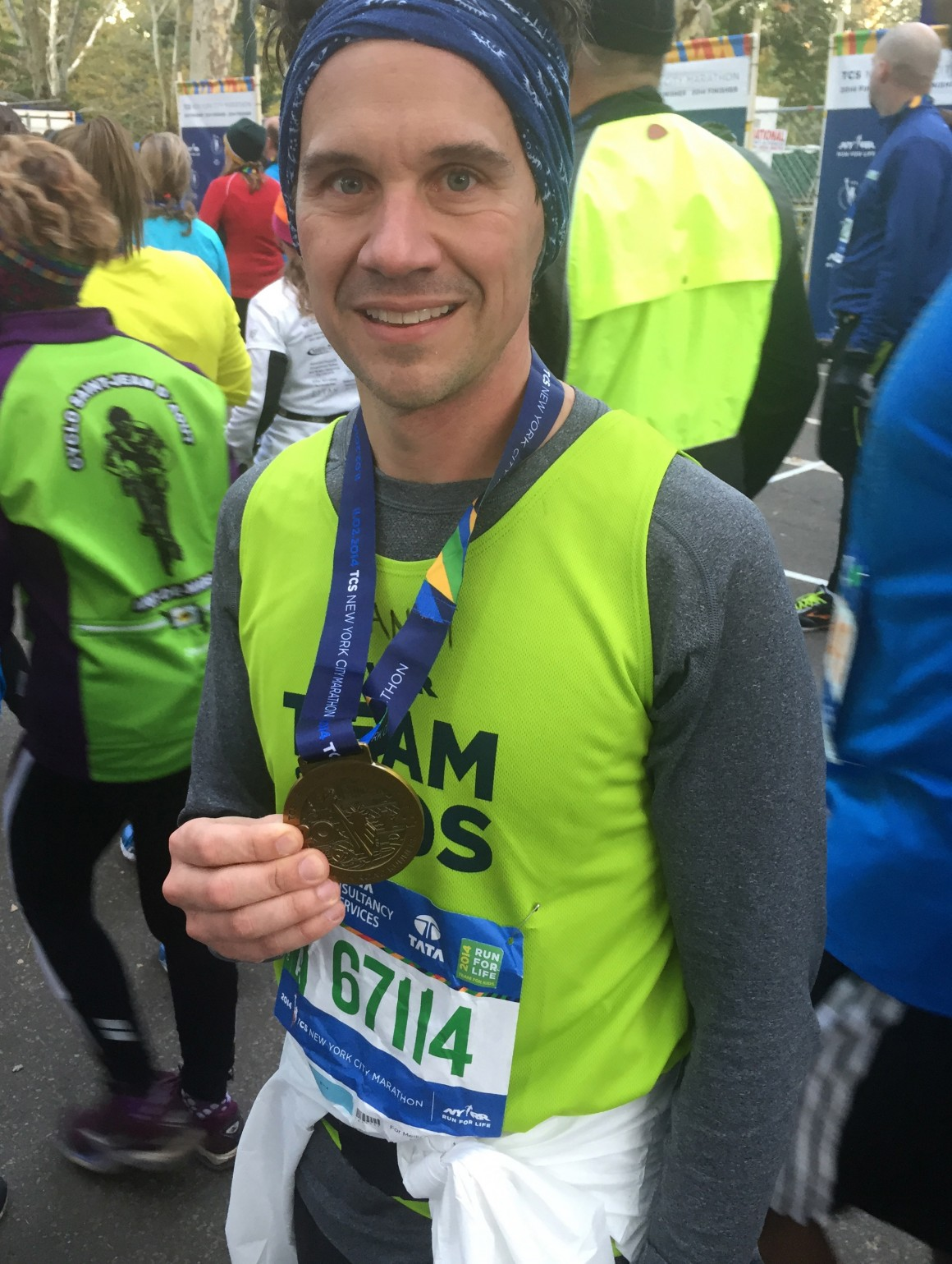 Psychology teacher Danny Carragher with his medal from the 2014 NYC Marathon - his first marathon ever!