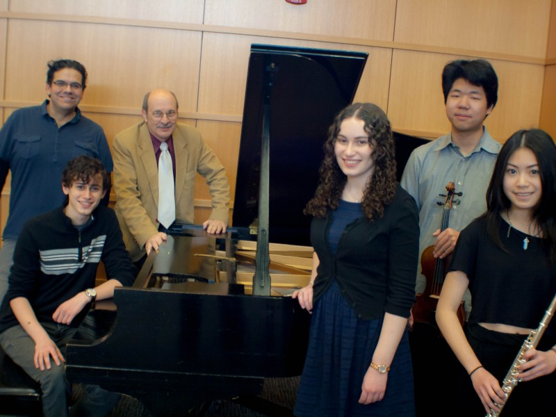 The winners and honorable mentions are picture with orchestra conductor Diego Garcia (standing, far left) and Performing Arts Chair John Littlefield (standing, center), from left: Elliot Roman '17 (seated at piano), Danielle Roman '15, Lawrence Chiang '17 and Angela Zhang '18.