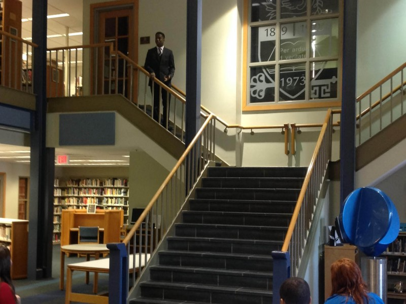 Ehren Layne '19 performs during the Eighth Grade Poetry Festival on January 29 at the Imperatore Library.