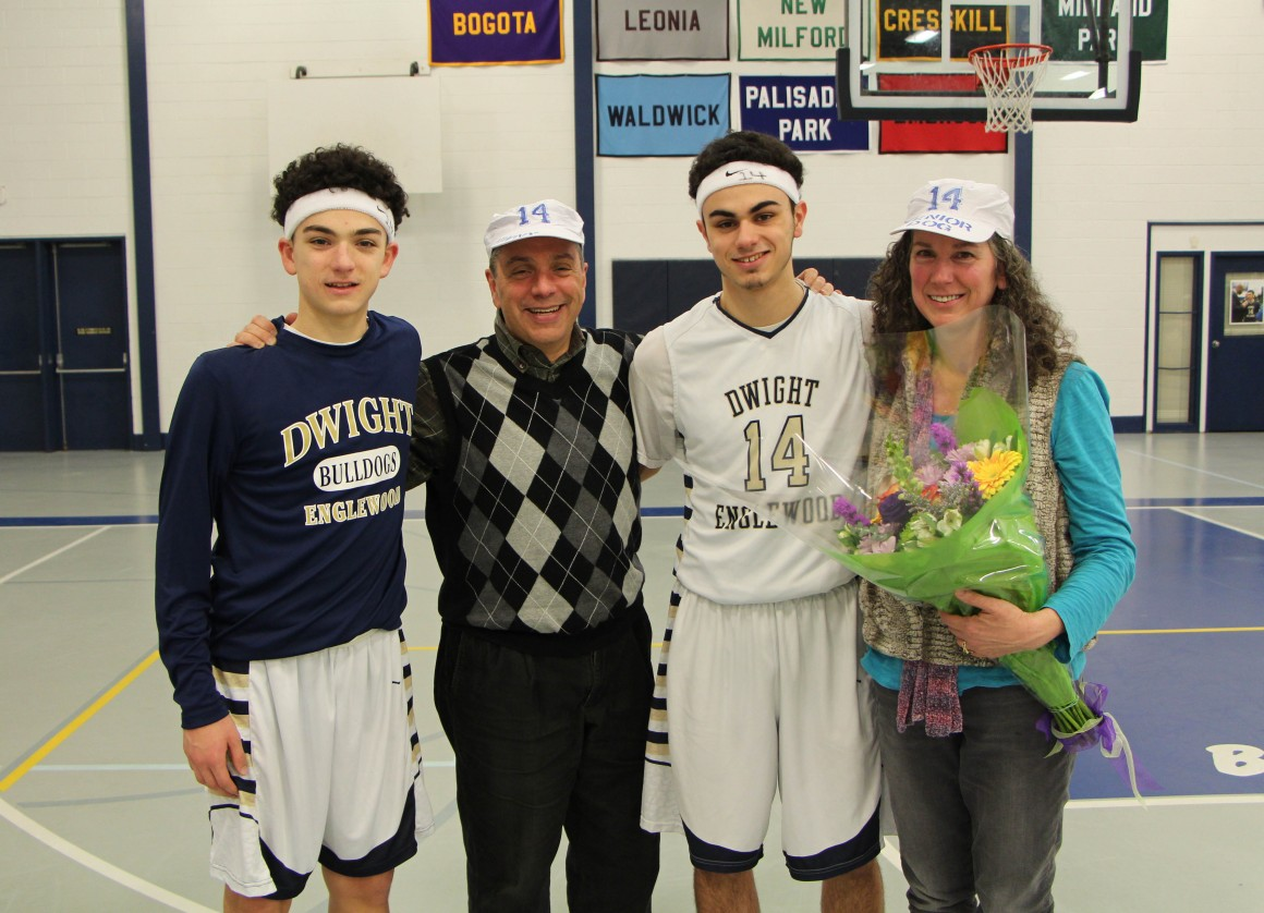 Vinny DeBellis '15 (third from left) and his family - Tony '18; dad and D-E Performing Arts faculty member Rob; and mom Amanda '76 - was honored during Senior Recognition Night on February 26, 2015.