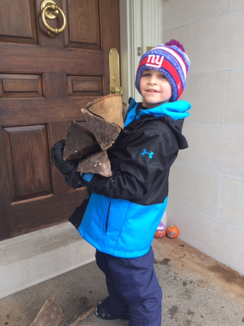 "Danny Lax '24 carried firewood as one of the household tasks that he took on for the ""Third Graders Making a Difference"" project."
