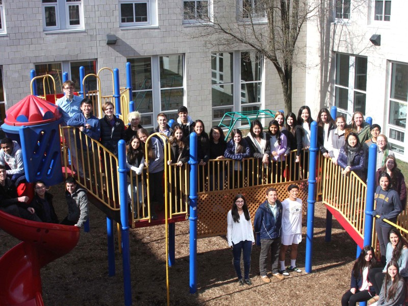 "The Class of 2015 D-E ""Lifers"" gathered this spring for a final group photo on some familiar territory: the Lower School playground."