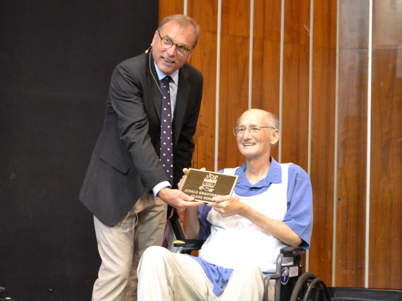 Head of School Dr. De Jarnett presented Kraut with a bronze plaque identical to the one now found by the entryway of the Jerald Krauthamer Classroom.