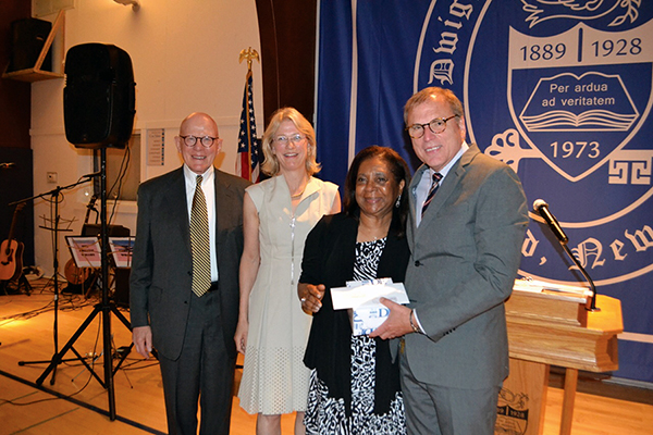 Diane Christian, a member of the English Department faculty, received the Geralyn Kossmann Award, established in memory of Geralyn Kossmann, beloved nurse and assistant athletic director at D-E.  Joining Dr. De Jarnett to present the award to Diane were Cynthia Kossmann Wilkinson '80 and her father Dr. Richard Kossmann.